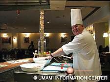A chef preparing tasting plates