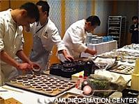 Chef Murata prepares dishes